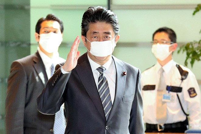 Japan extends virus state of emergency until May 31
