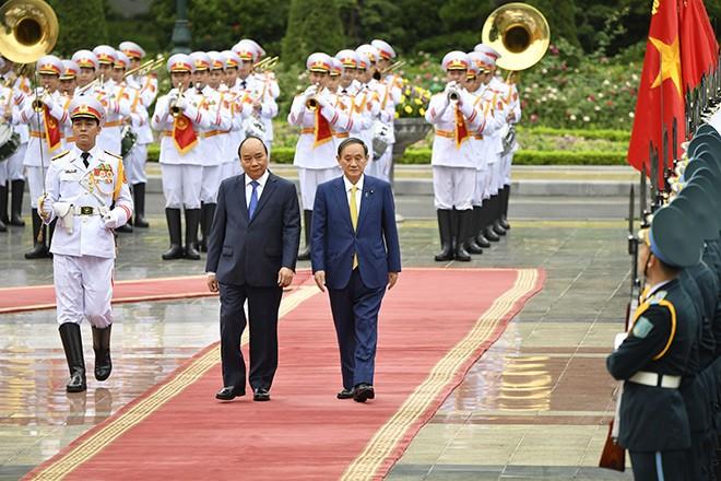 Japan Prime Minister Suga Travels to Vietnam for Bilateral Talks