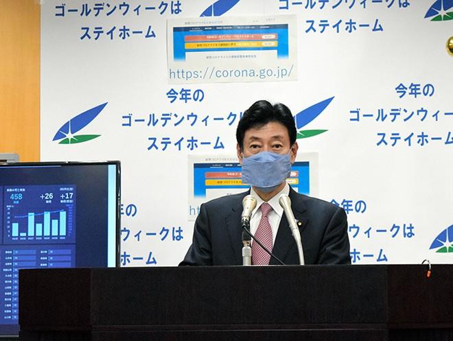 Japan extends virus state of emergency until May 31