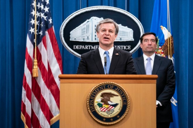 Justice Department charges 8 in Chinese harassment plot in U.S.
