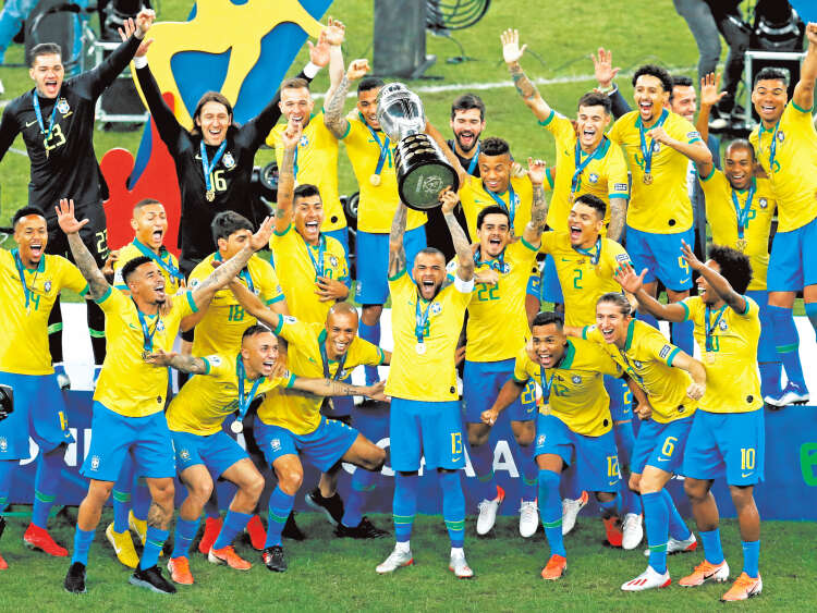 Brazil players celebrate with their trophy after a 3-1 victory over Peru in the final soccer match of the Copa America at the Maracana stadium in Rio de Janeiro, Brazil, Sunday, July 7, 2019. (AP Photo/Natacha Pisarenko)