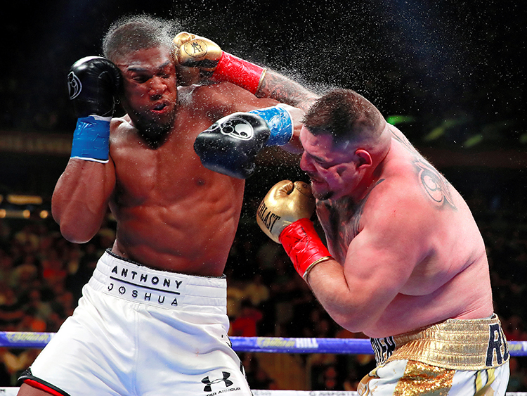 Boxing - Anthony Joshua v Andy Ruiz Jr - WBA Super, IBF, WBO & IBO World Heavyweight Titles - Madison Square Garden, New York, United States - June 1, 2019   Andy Ruiz Jr in action with Anthony Joshua  Action Images via Reuters/Andrew Couldridge