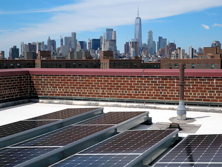 Solar Panels on a roof in New York, June 11, 2019. Manhattan now has the country's biggest array of solar panels on an apartment complex and the Bronx could soon have a bigger one. (Gabriella Angotti-Jones/The New York Times)