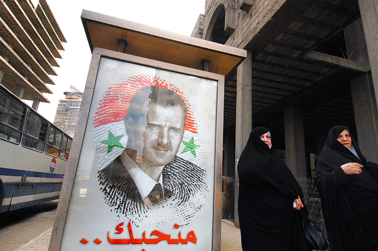 FILE -- A poster of President Bashar Assad in Damascus, Syria, on May 11, 2007. The Syrian government has denied the existence of systematic abuse. However, newly discovered government memos show that Syrian officials who report directly to Assad ordered mass detentions and knew of atrocities. (John Wreford/The New York Times)